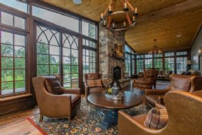 Sun Room Fireplace - Country homes for sale and luxury real estate including horse farms and property in the Caledon and King City areas near Toronto