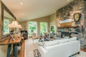 Living Room with Stone Fireplace - Country homes for sale and luxury real estate including horse farms and property in the Caledon and King City areas near Toronto