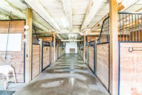 Barn Aisle - Country homes for sale and luxury real estate including horse farms and property in the Caledon and King City areas near Toronto
