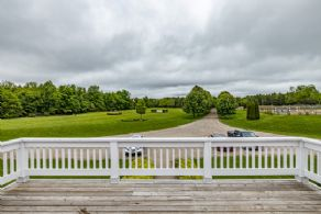 Deck Overlooking Derby Field and Outdoor Ring - Country homes for sale and luxury real estate including horse farms and property in the Caledon and King City areas near Toronto