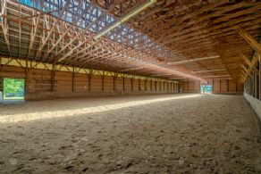 Indoor riding arena - Country homes for sale and luxury real estate including horse farms and property in the Caledon and King City areas near Toronto